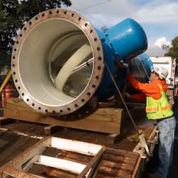 Workers in Portland, Oregon, prepare to install a Lucid Energy pipe below ground.